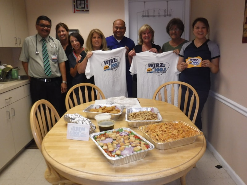 Karen Hands and staff from Ponnambalam & Shah MDs in Toms River enjoy FREE Lunch from Bum Rogers Crabhouse