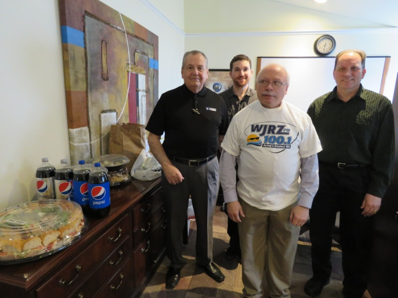James Pomposello and staff from Hammer Fiber Optic Investments in Pt. Pleasant Beach enjoy FREE Lunch from Mulberry Street