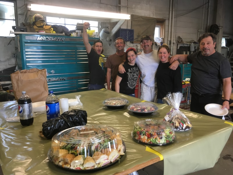Teri Faccibene and crew from Monmouth Auto Body 2 in Manasquan enjoy FREE Lunch from Mulberry Street