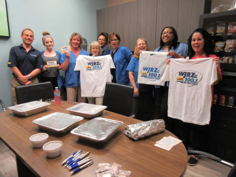Kelly Dimesa and staff from Orthopaedic Institute in Toms River enjoy FREE Lunch from Bum Rogers Crabhouse