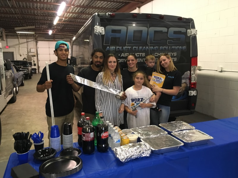 Natalie Gray and crew from Air Duct Cleaning Solutions in Toms River enjoy FREE Lunch from Bum Rogers Crabhouse