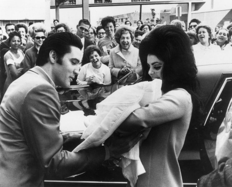 Elvis and Priscilla Presley with their daughter, Lisa Marie, born on 2nd February.  (Photo by Keystone/Getty Images)