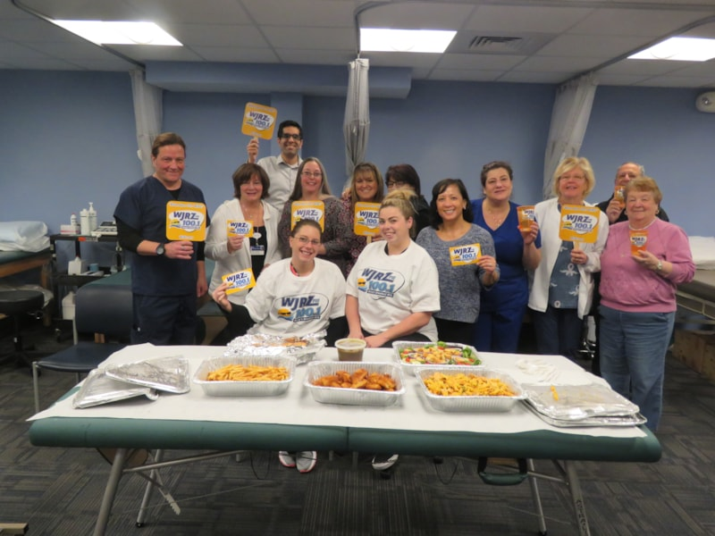Keith Caruana and staff from Meridian Occupational Health in Lakewood enjoy FREE Lunch from Bum Rogers Crabhouse