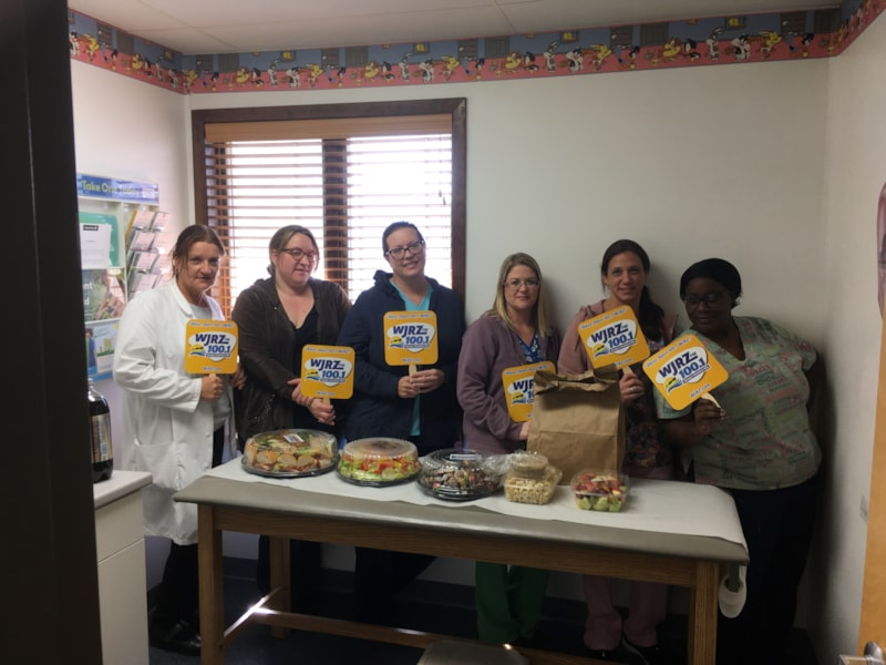Marcie McCombie and staff from Norman E. Santo-Domingo, MD in Bayville enjoy FREE Lunch from Mulberry Street